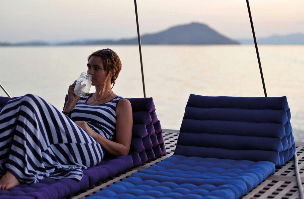 Lady lounging on the deck of Dunia Baru