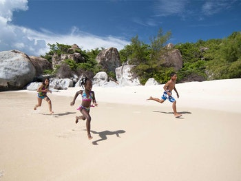 Kids Running on the sand in the BVI