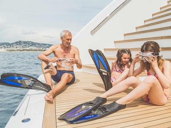 Family on SUERTE's aft deck about to go snorkeling