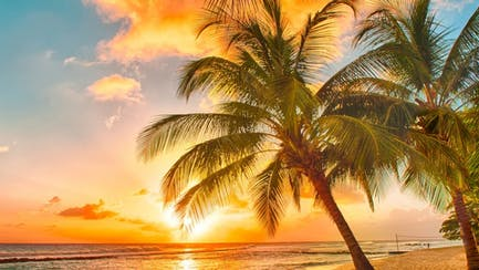 Barbados yacht charter cruising in luxury at sunset on Caribbean