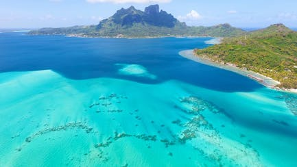aerial of Tahiti yacht charters at anchor in clear blue ocean