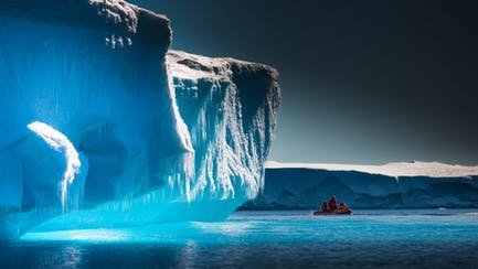 blue glaciers and passenger boat from yacht charter Antarctica