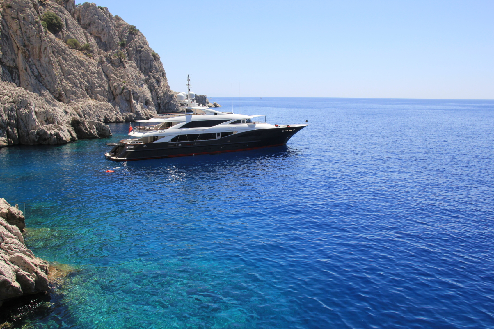 Liberty yacht for charter at anchor in mediterranean sea off coast