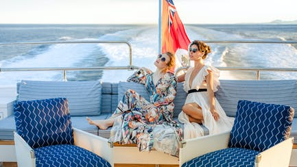 Two girls on board a superyacht for charter