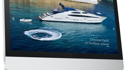 Computer screen showing custom website of a superyacht for sale
