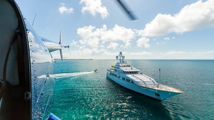 Superyacht for sale anchored at sea seen from helicopter