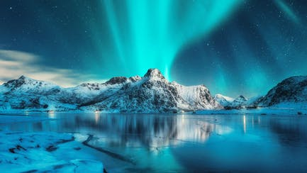 Aurora Borealis over Lofoten Island mountains from Scandinavia luxury yacht charter in Norway