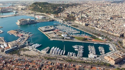 aerial view of port vell and superyachts in barcelona spain