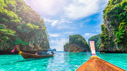 Traditional Thai fishing boat on blue waters
