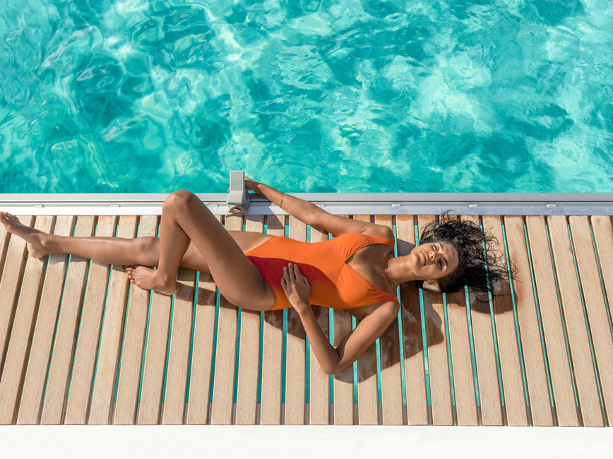 Lady Lounging by a Pool