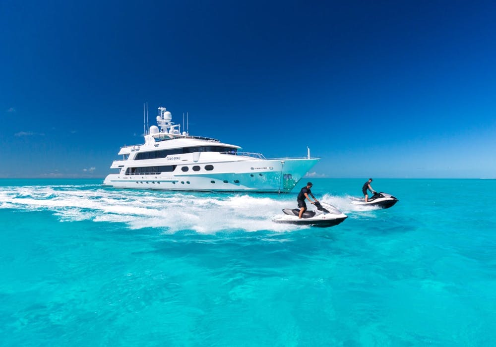 Charter yacht Casino Royale Profile with Jet Skis in front