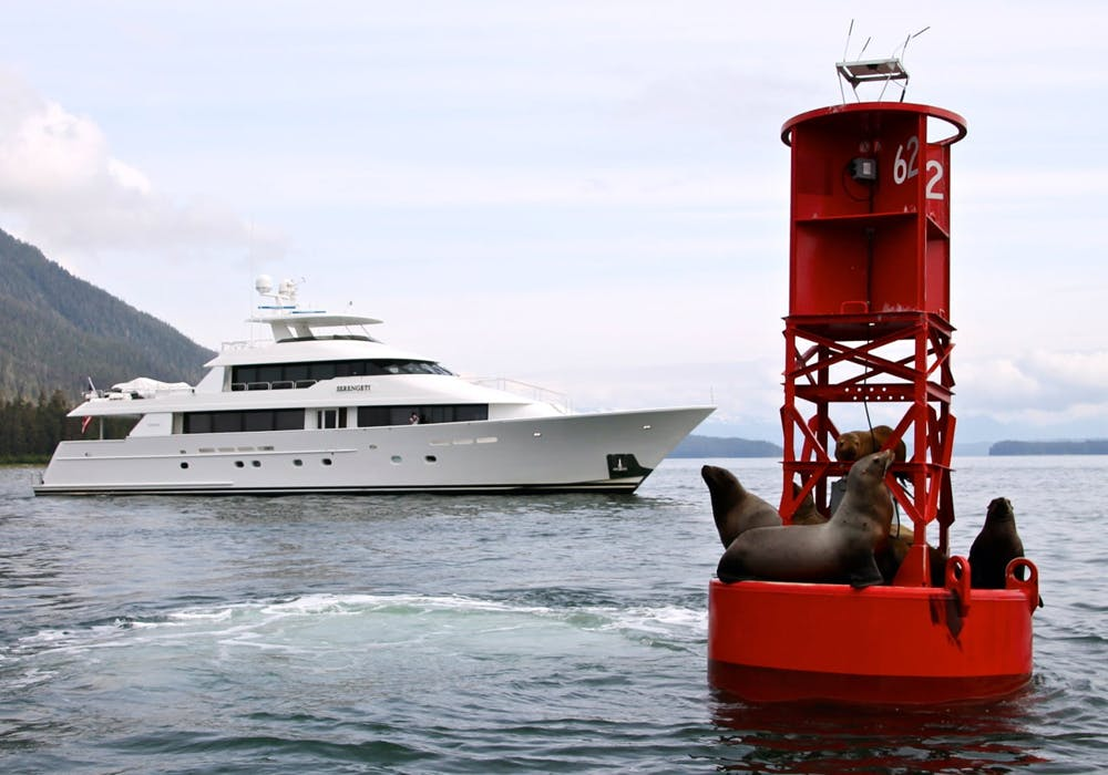 Charter Yacht SERENGETI by a channel marker that with seals in Alaska