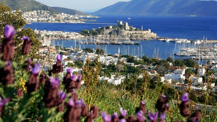 scenic view of Bodrum Castle and luxury yachts for charter in Turkey and the Aegean Sea