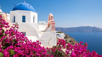 Greece yacht charter view of cycladic houses and flowers in oia village santorini