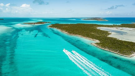 aerial of private yacht charter in exuma bahamas islands with crystal clear water