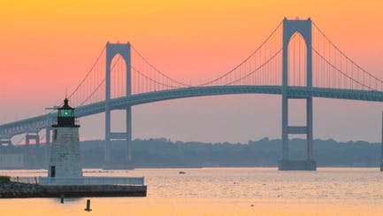 New England yacht charters overlook Newport harbor lighthouse and bridge in Narraganset Bay