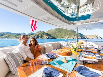 Couple eating breakfast on charter yacht KING BABY in the Caribbean