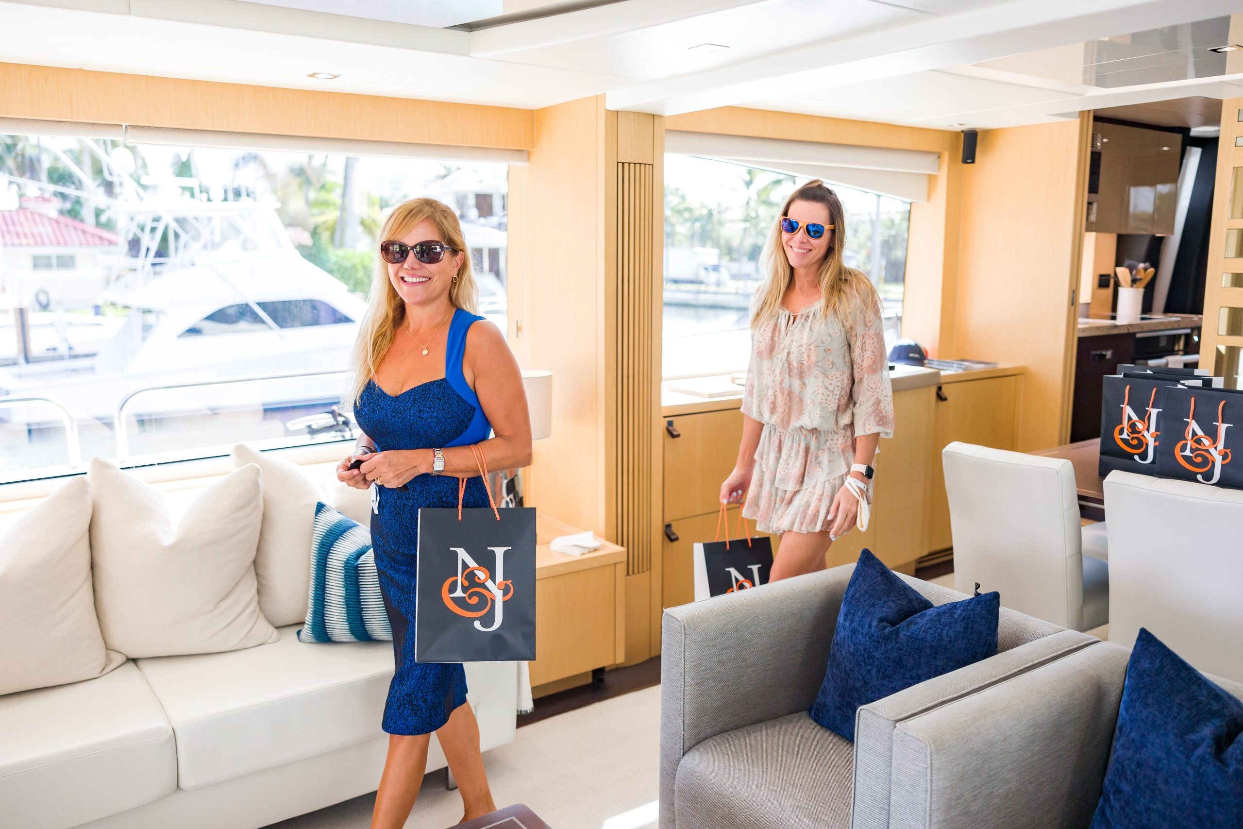 Guests touring the 86-foot Sunseeker yacht for sale PURA VIDA