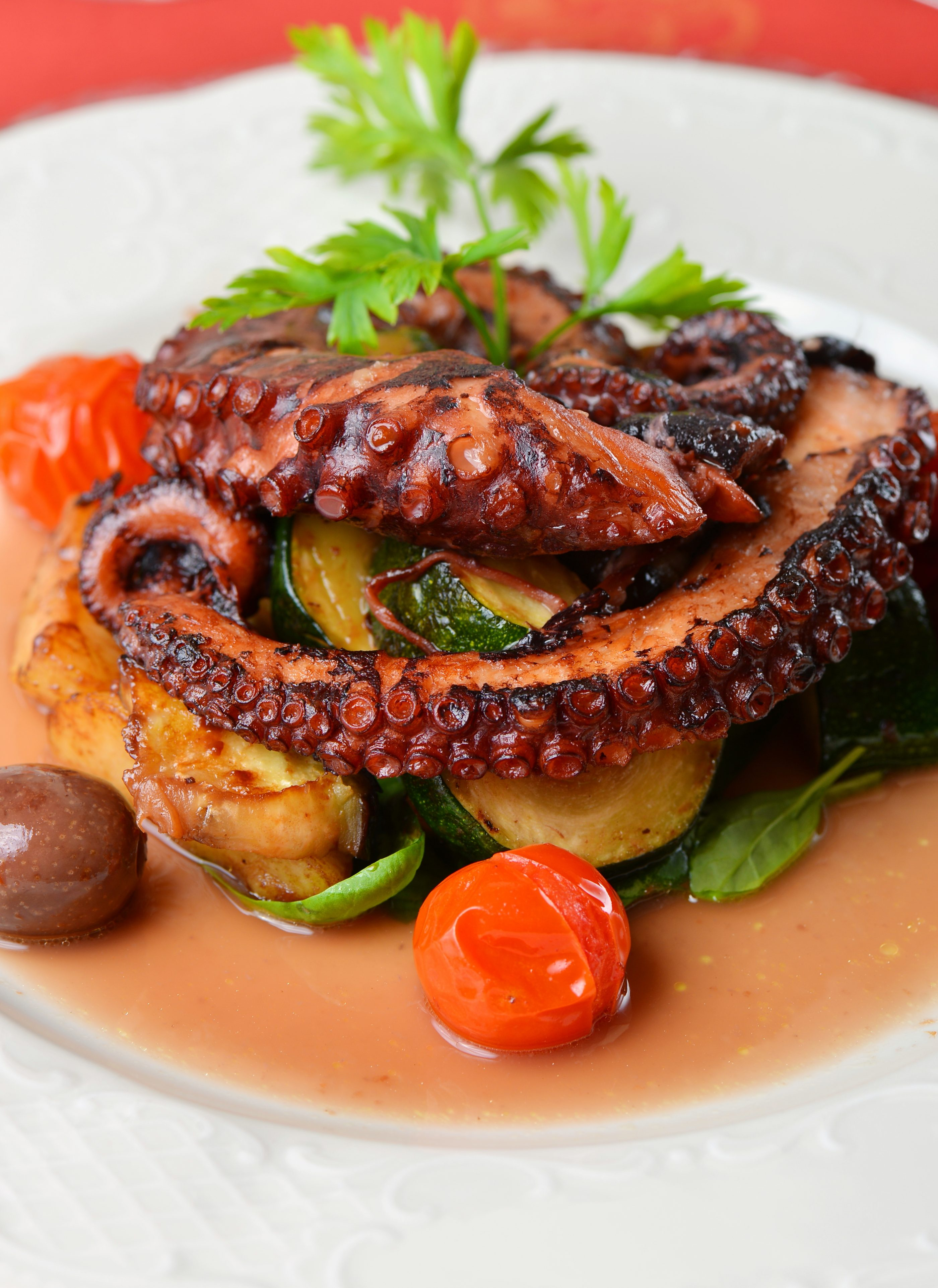 Fresh Grilled Octopus With Olives Potato Tomatoes Zucchini Vegetable