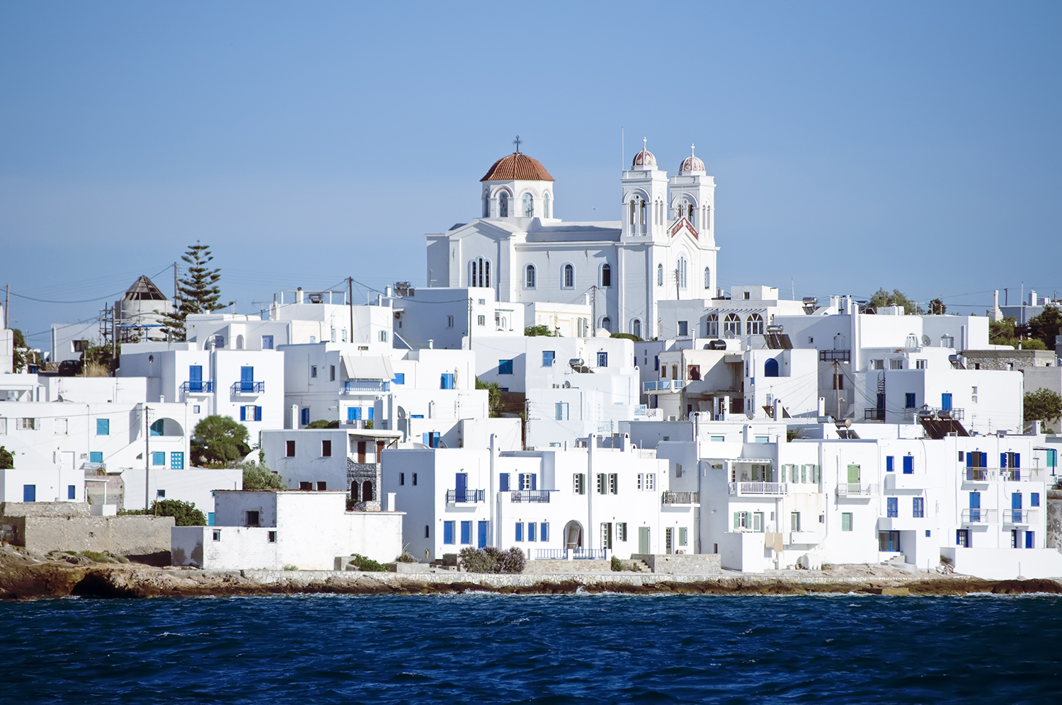 Greece Island of Paros with Village Of Naoussa view from yacht charter in Mediterranean sea