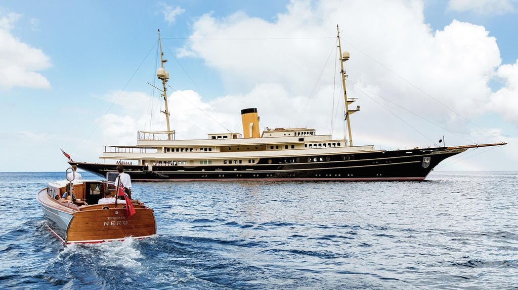 NERO yacht charter at anchor with classic tender
