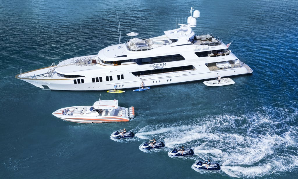 164' (50m) trinity charter yacht OCEAN CLUB profile with tender and jetskis in front