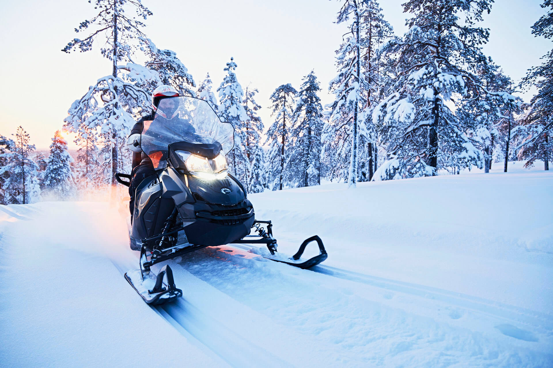 Snowmobile in the forest of Lapland
