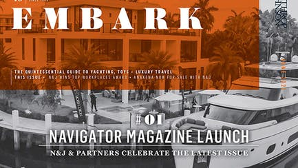 House with a yacht out back and a overlay in orange that says Embark, June 2021, Navigator Magazine Launch