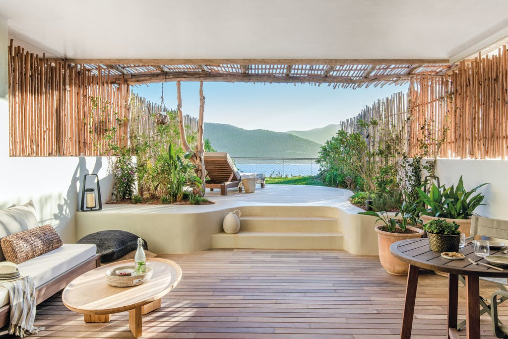Six Senses Ibiza building terrace with private sundeck and view of the bay