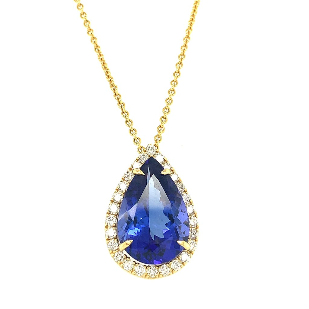 Large tanzanite gem surrounded by diamonds on a gold chain by Lisa Nik