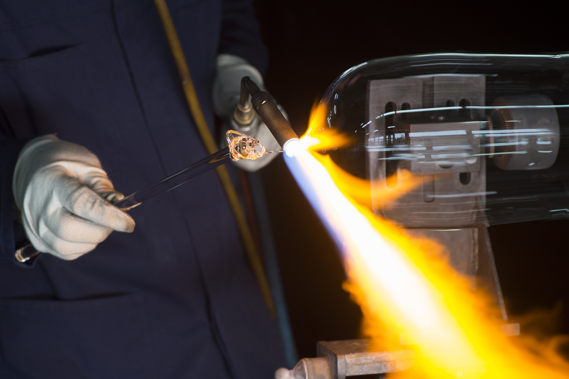 Horologist using a blow torch to mold the glass on Ulysse Nardin's UFO timepiece