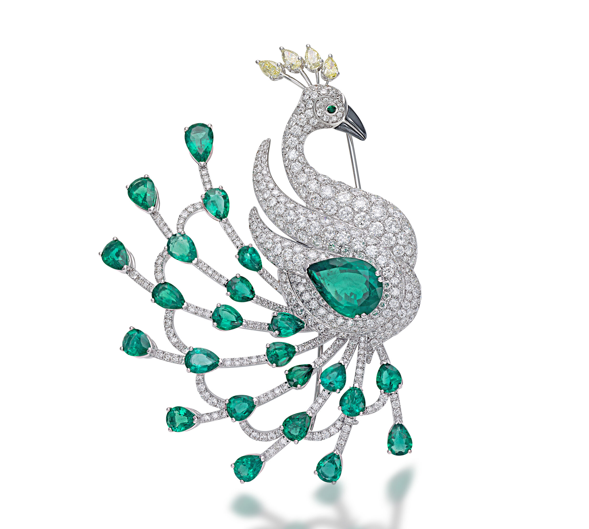 Peacock brooch with emeralds, white diamonds, yellow diamonds and hematite by Picchiotti