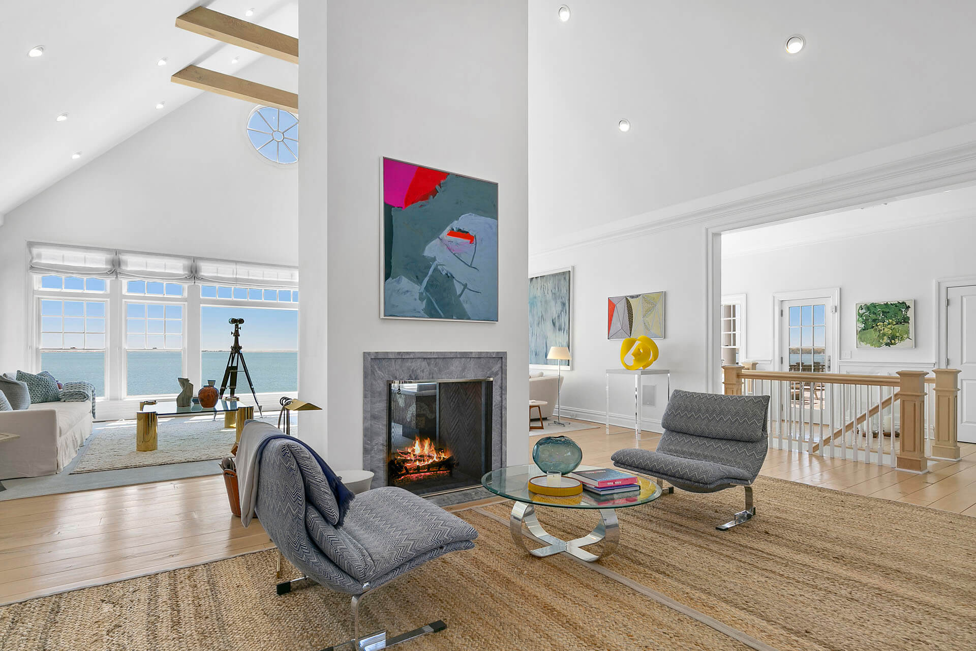 Seating area with a fireplace and ocean views