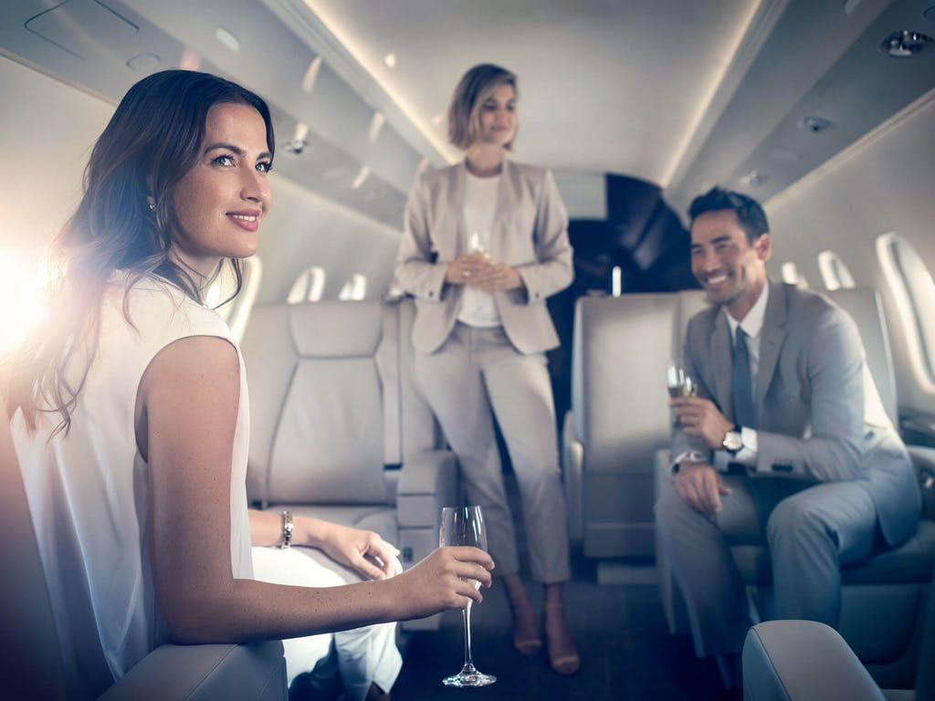 People on a private jet drinking champagne