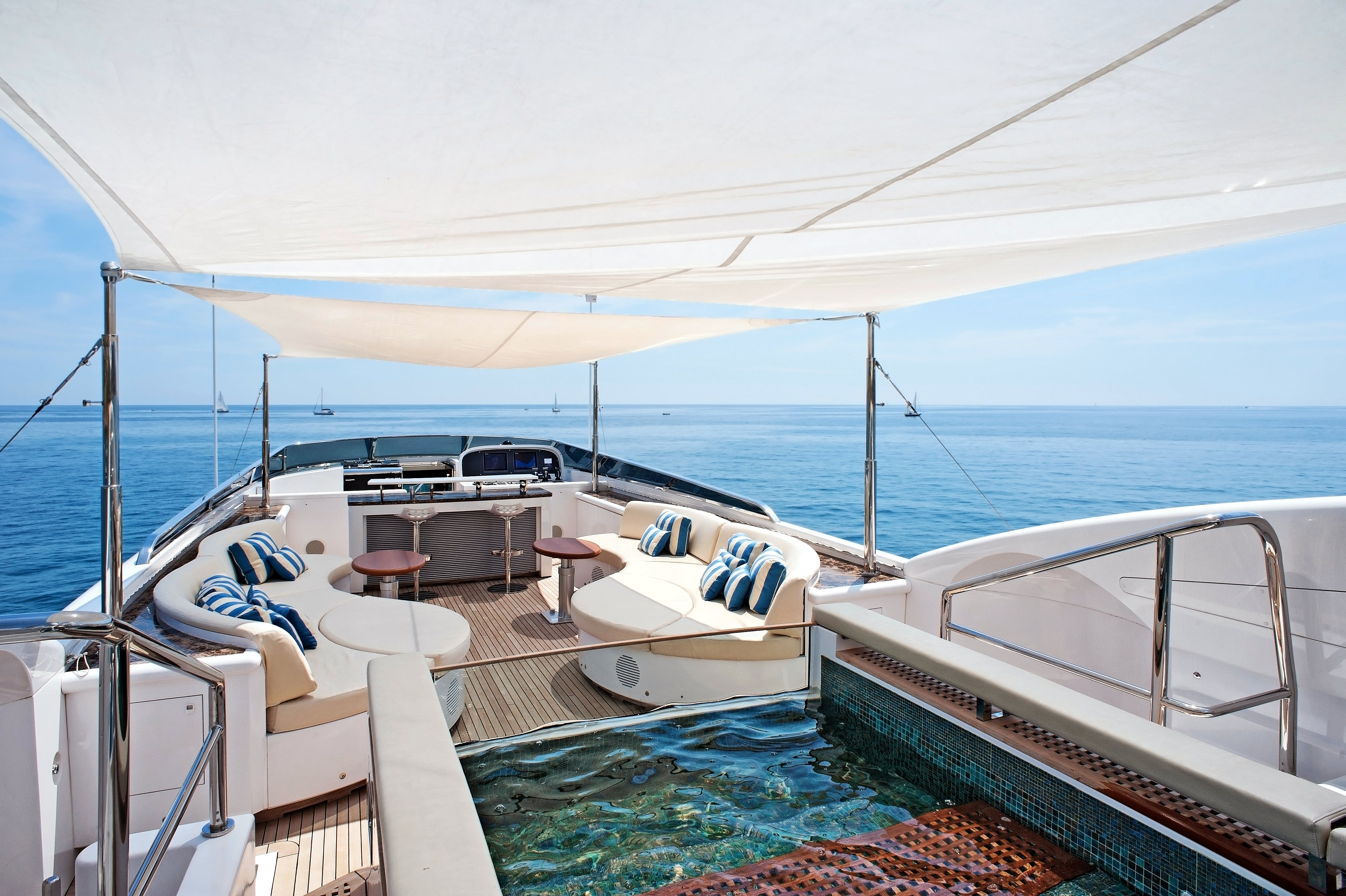 Alfresco lounge area of charter yacht TUTTO LE MARRANE on water.