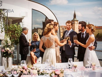 Guests aboard a yacht toasting champagne