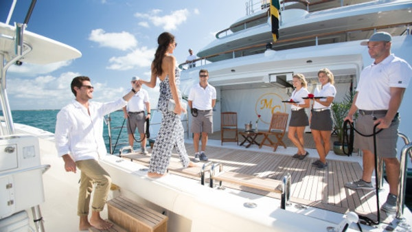 LUMIERE II guests embarking yacht