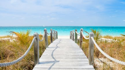 idyllic private beach with Turks and Caicos luxury yacht charter cruising caribbean sea