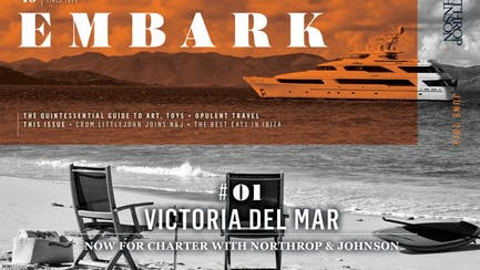 Main Embark image featuring a superyacht for charter seen from the beach