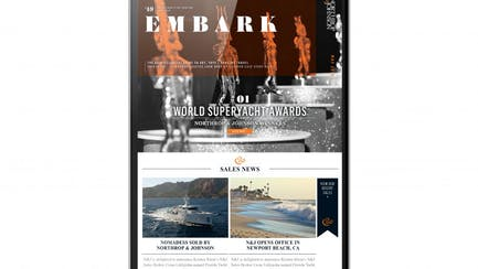 Digital newsletter showing yachts for sale displayed on tablet