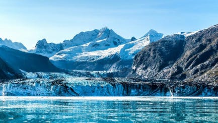 View of mountains from ocean in Glacier Bay Alaska Yacht Charter