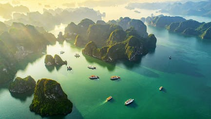 South East Asia luxury yachts for charter at anchor in Vietnam Halong Bay