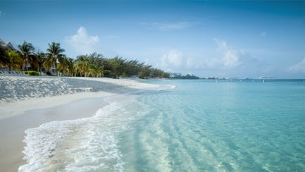 Cayman island luxury yacht for charter at anchor near Caribbean Island white sand beach