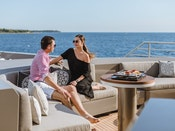 model couple relaxing on a private Bahamas yacht charter
