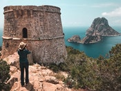 woman at Savinar Towar in islets of es vedra cala dhort and ibiza yacht charters in spain