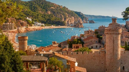 view of luxury yachts and castles in Tossa de Mar Costa Brava in Catalunya Spain