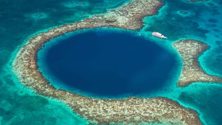 belize yacht charter anchored off big blue hole central america