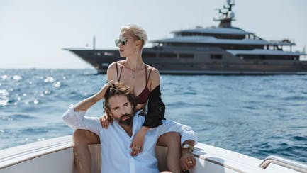ultra high net worth couple on luxury tender with M/Y Solo for charter in Mediterranean on horizon